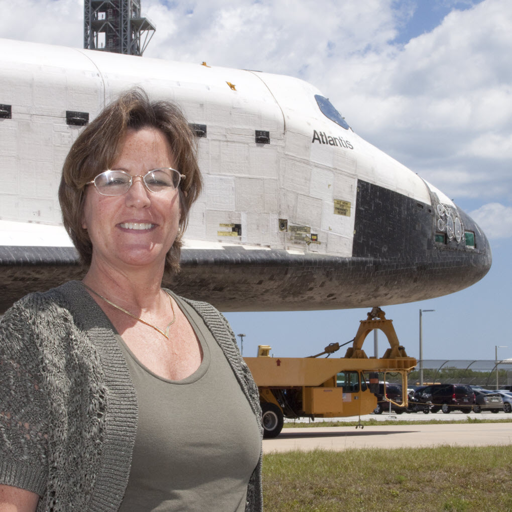 Lori Burke with Shuttle Atlantis